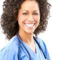smiling medical assistant wearing a stethoscope